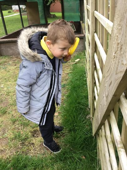 Alfie had lots of fun looking for bugs with his magnifying glass.