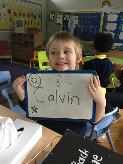 Calvin traced over his name during play
