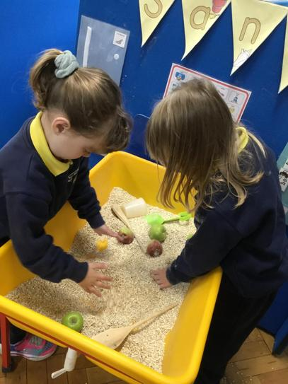 Hollie and Olivia exploring the oats in our sand tray, it smelled of cinnamon too.