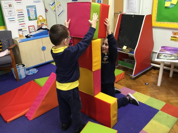 What a big tower you both are building!