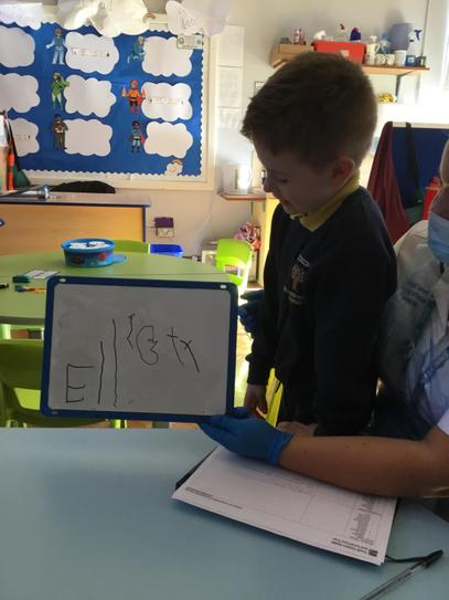 Elliott did lovely work copying his name onto the whiteboard.