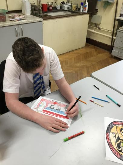 Jason colouring in his favourite football players