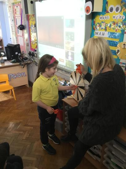 During mental maths Amelia spun the wheel of fortune and then added one on.