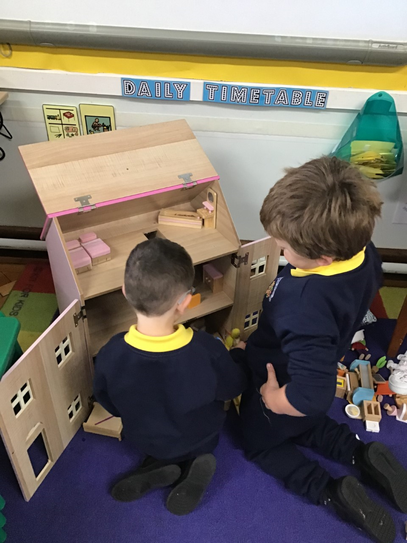 Jack and Sam playing with our dolls house.