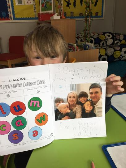Lucas' labelled his family photo and copied the names from a whiteboard.
