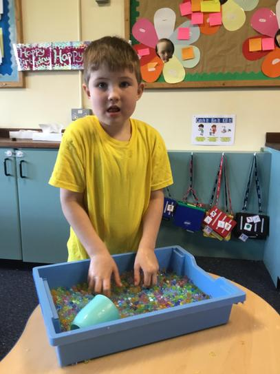Rory loved the waterbeads... they did not stay in the tray for long!