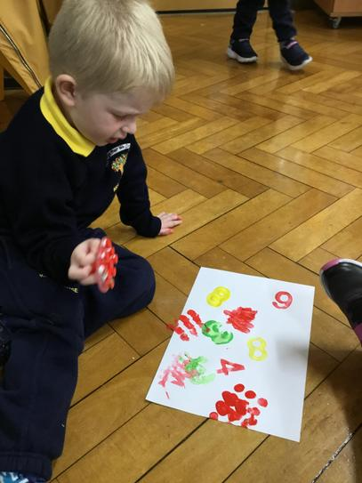 Henry is also busy stamping some numbers for our clocks.