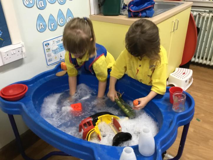 Olivia and Hollie making bubbles.