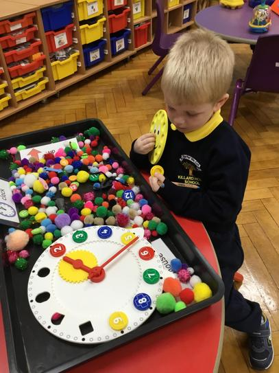 Henry is exploring our Hickory Dickory sensory tray.