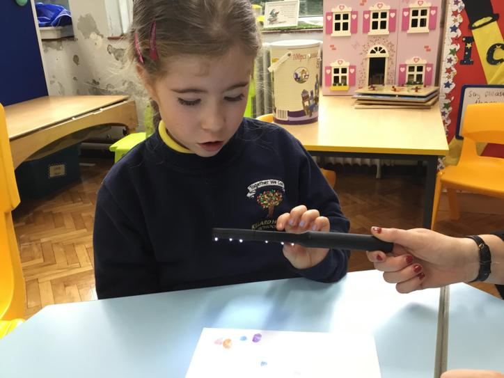 Amelia looking at her very special fingerprint during topic work.