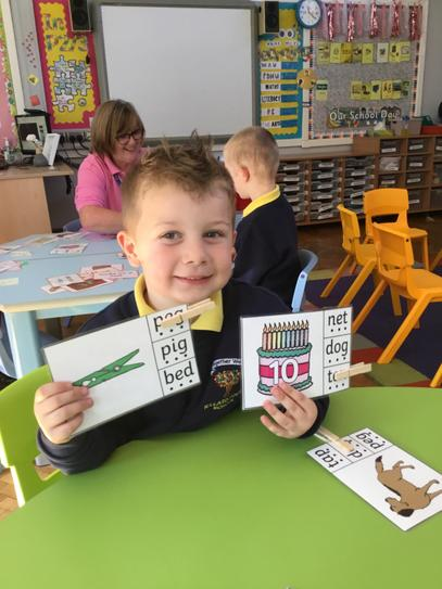 Alfie read the words and put a peg on the correct word, he did so many!