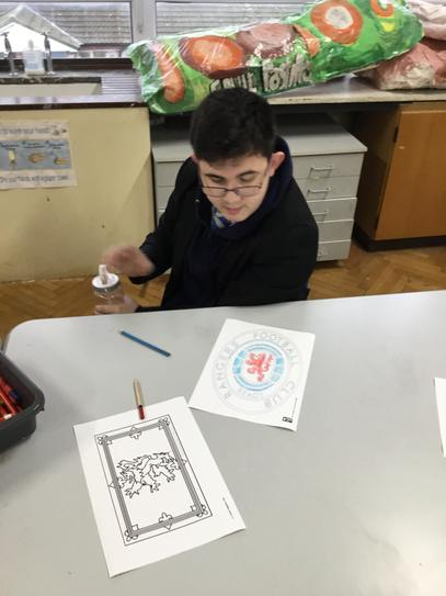 Dylan colouring his favourite football team crest