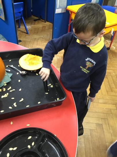Jack using tweezers to remove the pumpkin seeds.