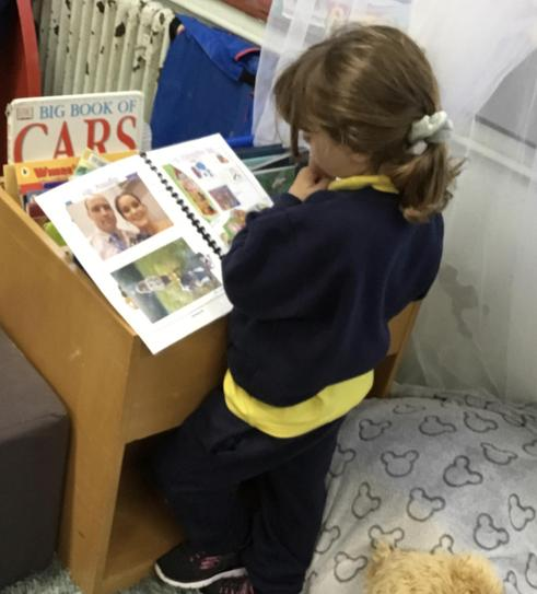 The 'All about me' books are always a hit! Hollie loves looking at her family.
