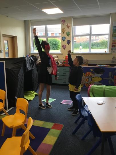 Milo and Miss Presho pretended to fly like superheros