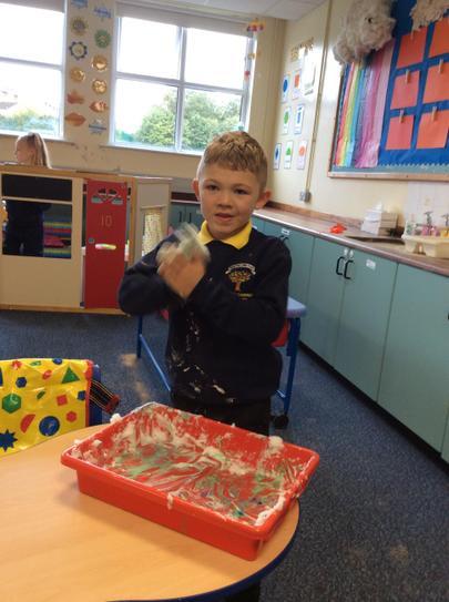 Brodie loved messy play - look at that uniform!
