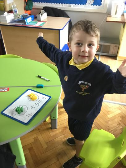 Alfie was able to split the fruits in to two parts and with help wrote the number sentence