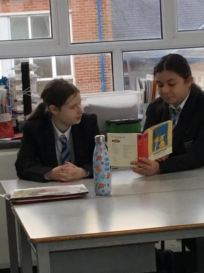 Jasmine and Rachel reading together.