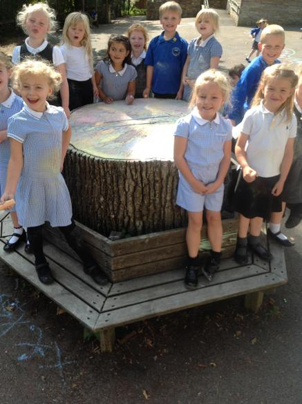 We have made the most of the sunshine and created an amazing rainbow tree trunk with chalk