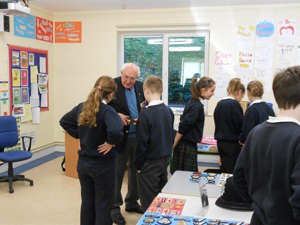 Children asking Albert some qusestions