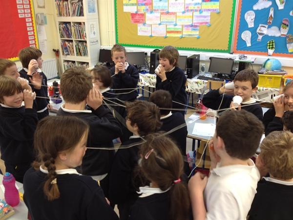 Talking on our string telephones!