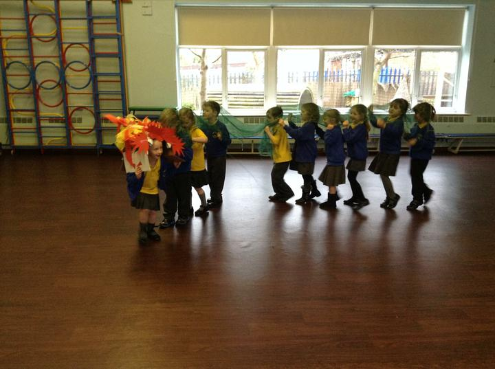 Dragon dancing to Chinese music in the hall.