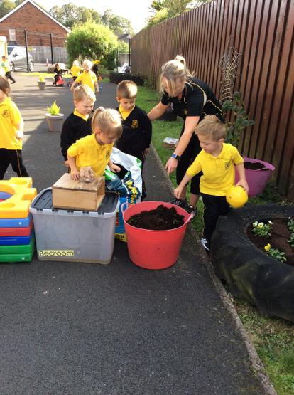 Working together to dig holes for the plants. 