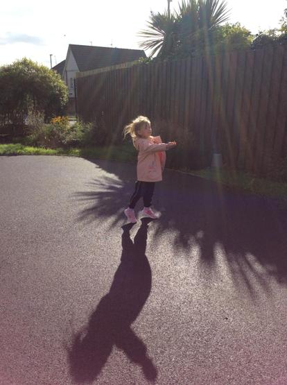 Enjoying making and looking at shadows on the ground!