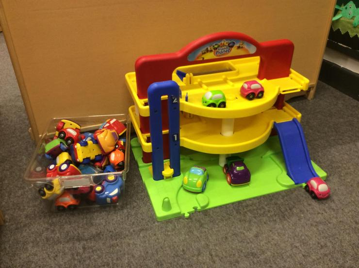 Cars and garage are a great floor play activity.