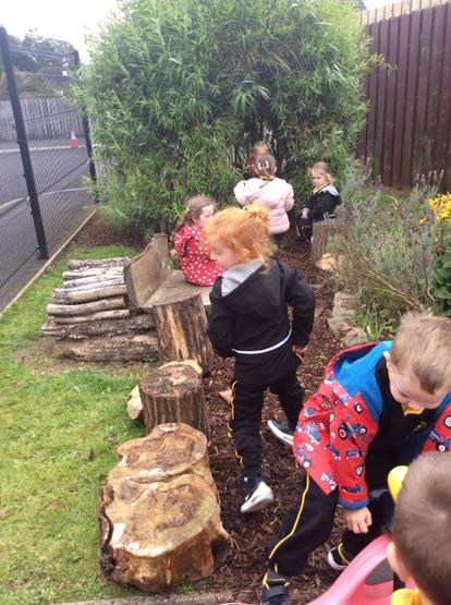 Exploring at the willow dome in the Nursery garden area.