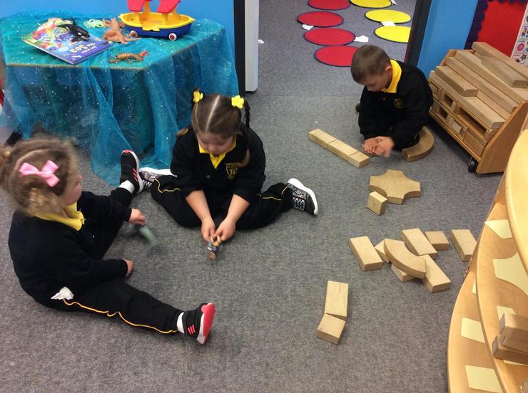 Using large wooden blocks to make great models.