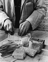 Here is a shopkeeper wrapping up some rations.