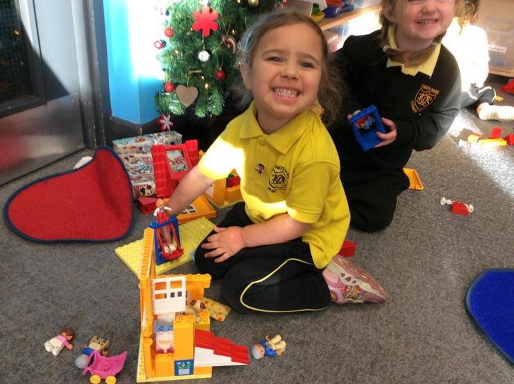 Playing with Duplo on the carpet area.