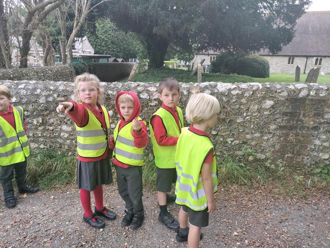 Excitedly pointing out the features of our village