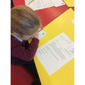Looking at letters.
