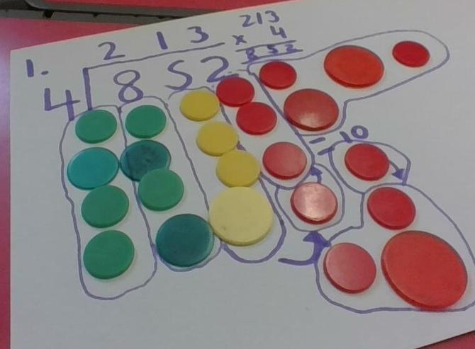 We have been practicing short division using counters.