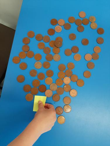 Counting 2 pence pieces.