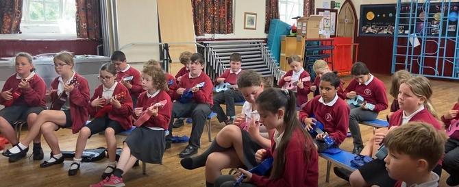 Y5 children listening carefully.