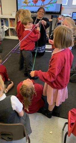 We doubled 10cm of ribbon, then 20cm, 40cm, 80cm, 160cm, 320cm  until we got to 640cm!