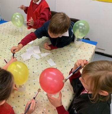 We made our balloons using paper mache techniques.