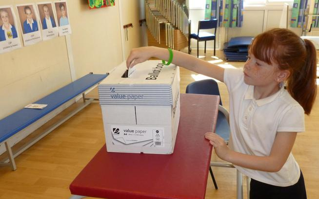 Lily casting her vote, learning about democracy