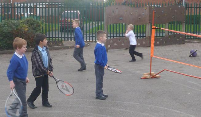 Playing tennis at lunchtime
