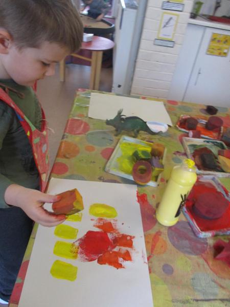 Using shape sponges to make a dinosaur