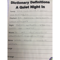 Using a dictionary to find out defination.