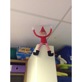 We found the Elf had climbed up the shelves.