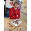 Exchanging coins and making totals.