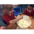 Adding chocolate to our ice cream!
