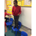 Kelechi standing on a chair!