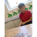 Making patterns using coins.