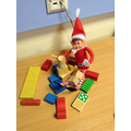 Elf was building with the blocks.